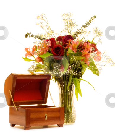 Jewelry Box and Flowers stock photo, An open jewelry box sitting next to a beautiful bouquet of roses, isolated on a white background by Richard Nelson