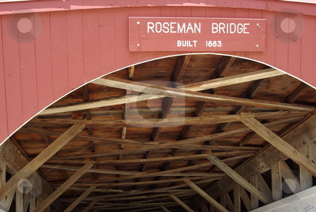Roseman Covered Bridge stock photo, The Roseman Bridge (built in 1883) is a popular tourist attraction for visitors to the sleepy town of Winterset, Iowa. The covered bridges in south central Iowa, not far from Des Moines, gained fame from the popularity of the movie and book,