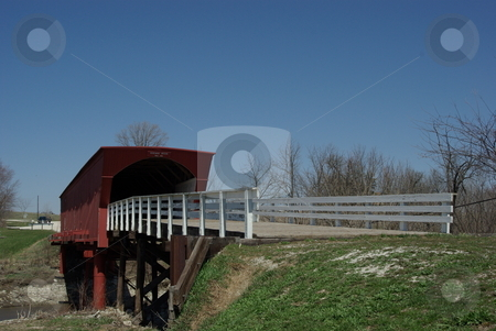 Old Roseman Covered Bridge stock photo, The Roseman Bridge (built in 1883) is a popular tourist attraction for visitors to the sleepy town of Winterset, Iowa. The covered bridges in south central Iowa, not far from Des Moines, gained fame from the popularity of the movie and book,