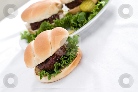 Fresh Hamburgers stock photo, Fresh hamburgers with lettuce and BBq sauce by Vince Clements