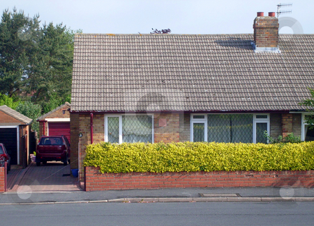 Typical English Bungalow stock photo, Typical English Bungalow on housing estate in Scarborough, England. by Martin Crowdy