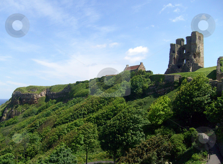 Scarborough Castle view stock photo, View of Scarborough's Norman Castle remains on castle headland, Scarborough, North Yorkshire, England. by Martin Crowdy