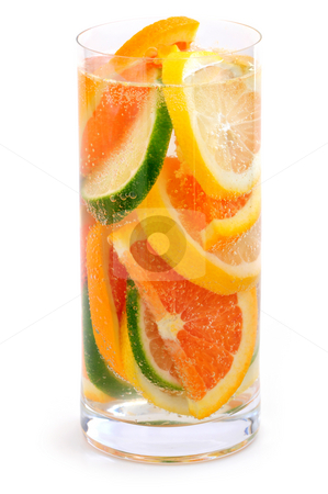 Citrus beverage stock photo, Bubbly beverage with citrus slices isolated on white background by Elena Elisseeva