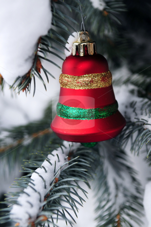 Christmas decoration stock photo, Christmas decoration hanging on snow covered spruce tree outside by Elena Elisseeva