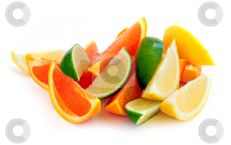 Citrus wedges stock photo, Wedges of assorted citrus fruits isolated on white background by Elena Elisseeva