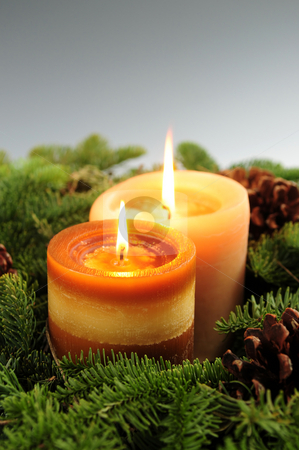 Christmas candles stock photo, Arrangement of burning Christmas candles and green spruce branches by Elena Elisseeva