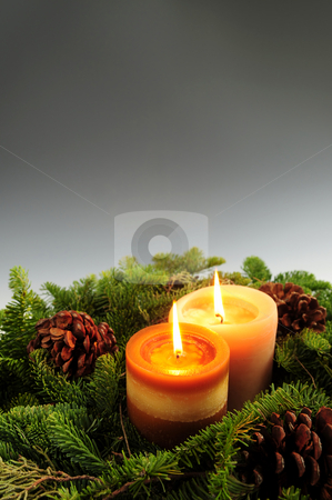 Christmas candles stock photo, Christmas arrangement of burning candles and green spruce branches, background by Elena Elisseeva