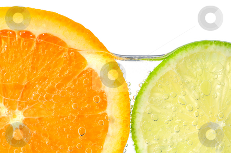 Orange and lime slices in water stock photo, Orange and lime slices in water with air bubbles on white background by Elena Elisseeva