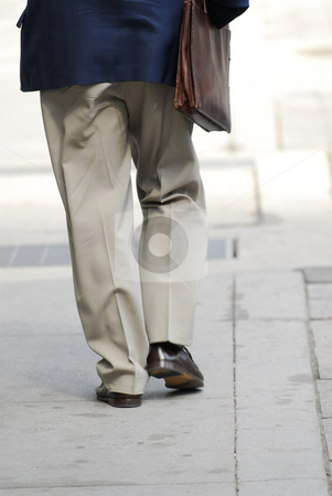 Businessman walking stock photo, Businessman walking on a busy street downtown by Elena Elisseeva