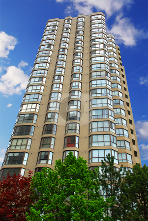 Apartment building stock photo, Tall condominium or apartment building in the city by Elena Elisseeva