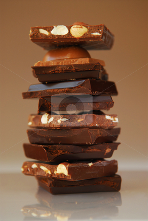 Chocolate stock photo, Stack of broken pieces of chocolate from assorted bars by Elena Elisseeva