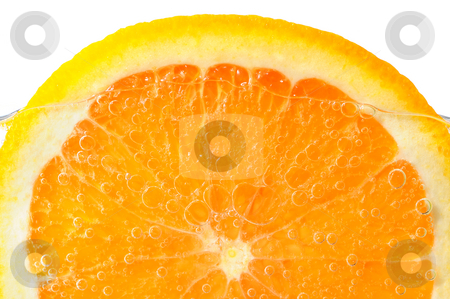 Orange slice in water stock photo, Orange slice in water with air bubbles on white background by Elena Elisseeva
