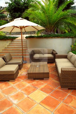 Patio of a villa stock photo, Patio of mediterranean villa in French Riviera with wicker furniture by Elena Elisseeva