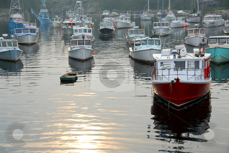 Fishing boats in harbor stock photo, Fishing boats in a harbor in Perkins Cove, Maine, on a foggy day by Elena Elisseeva