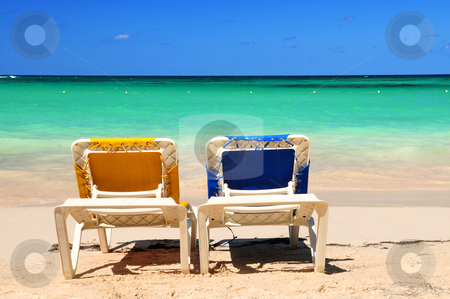 Chairs on sandy beach stock photo, Two vacation chairs on sandy beach of Caribbean island by Elena Elisseeva