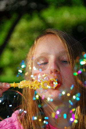 Young girl soap bubbles stock photo, Young girl blowing soap bubbles by Elena Elisseeva