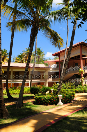 Hotel at tropical resort stock photo, Luxury hotel at tropical resort with palm trees by Elena Elisseeva