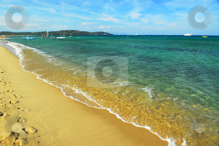 Mediterranean beach stock photo, Footprints on the golden sand of famous Pampelonne beach near St. Tropez in French Riviera by Elena Elisseeva