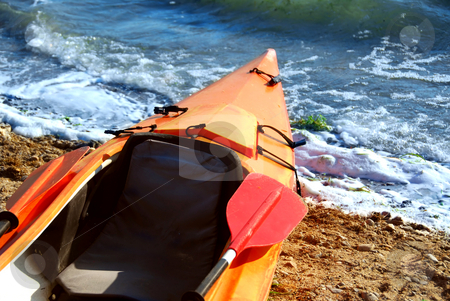Kayak stock photo, Orange kayak on a sandy shore of a river by Elena Elisseeva