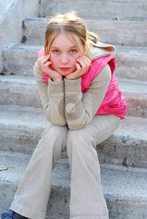 Girl on stairs stock photo, Young girl sitting on concrete stairs by Elena Elisseeva