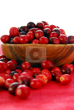 Cranberries in a bowl stock photo, Fresh red cranberries in a wooden bowl by Elena Elisseeva