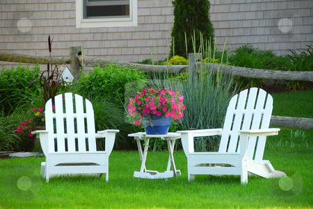 Two lawn chairs stock photo, Two lawn chairs in a beautifl garden near cottage by Elena Elisseeva