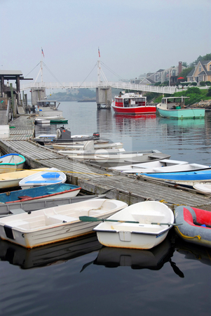 Boats in harbor stock photo, Boats in a harbor on a foggy day in Perkins Cove, Maine by Elena Elisseeva