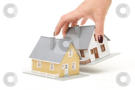Choosing A Home stock photo, Female hand choosing a house isolated on a white background. by Andy Dean