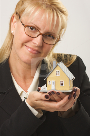 Woman Holding House stock photo, Female holding small house. by Andy Dean