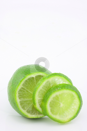 Lime stock photo, A lime, sliced and fanned out, isolated on a white background. by Jessica Tooley