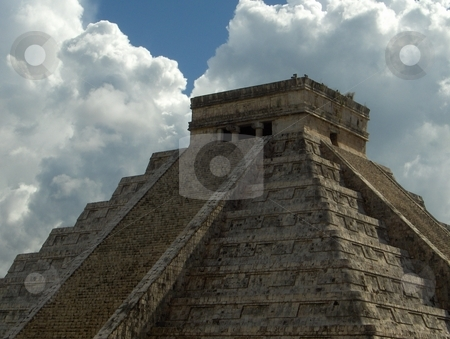 Chichen Itza stock photo, A pyramid at the Chichen Itza complex of ruins in Mexico, against a dramatic sky. by Jessica Tooley