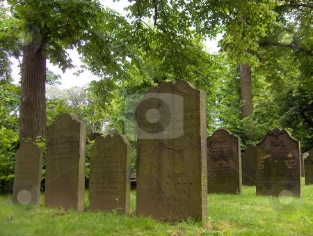 Rest stock photo, Old headstones in a green graveyard by Jessica Tooley