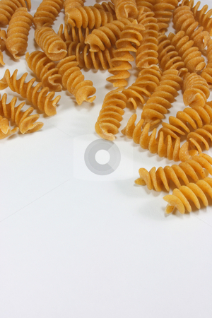 Rotini stock photo, Rotini pasta isolated on white. by Jessica Tooley