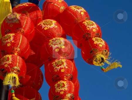 Chinese New Year stock photo, Chinese New Year decorations - red paper lanterns. by Jessica Tooley