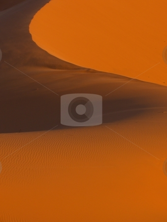Sand Ridge stock photo, A sand ridge shaped by the wind in the desert near Merzouga, Morocco by Jessica Tooley
