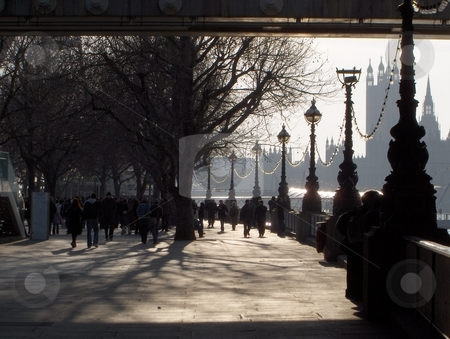 South Bank Walk stock photo, A crowd walking on the south bank of the Thames in London, UK in wintertime. by Jessica Tooley