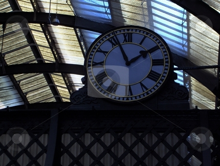 Time stock photo, A low angle view of a clock in a train station. by Jessica Tooley