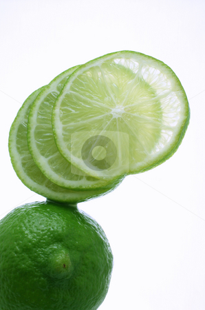Lime stock photo, A lime, sliced and fanned out isolated on white by Jessica Tooley