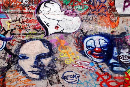Extensive Graffiti stock photo, A display of graffiti, including a heart, faces and a clown by Philippa Willitts