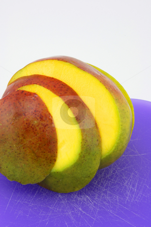 Mango stock photo, A mango sliced and fanned out by Jessica Tooley
