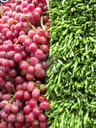 Grapes and Beans stock photo, Grapes and green beans at a vendor's stall by Jessica Tooley