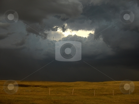 Storm stock photo, Storm clouds over the prairie. by Jessica Tooley