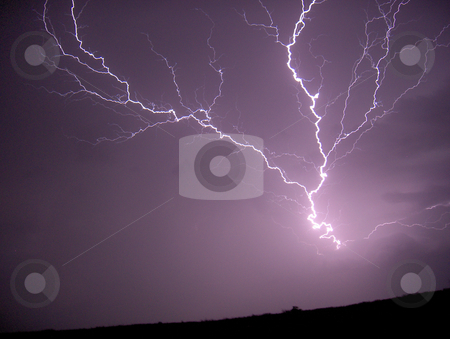 Lightning Strike stock photo, A bolt of lightning on a dark stormy night. by Jessica Tooley