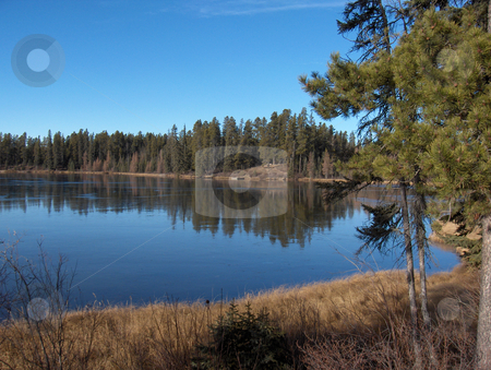 Northern Lake stock photo, A calm peaceful lake on a sunny day by Jessica Tooley