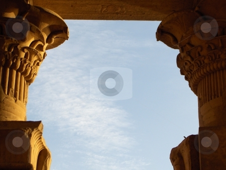 Pillar Tops stock photo, Carved pillars framing a blue sky at a monument in Egypt. by Jessica Tooley