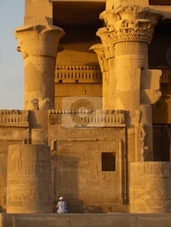 Kom Ombo Temple stock photo, An Egyptian man examining a wall at the Kom Ombo Temple in Egypt by Jessica Tooley
