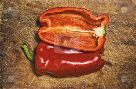 Red pepper  stock photo, Red pepper on old  cutting table. by Pablo Caridad