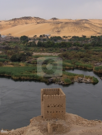 Tower on  the Nile stock photo, A crumbling tower overlooking the Nile in Egypt. by Jessica Tooley