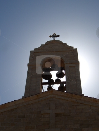 Church Bells stock photo, A backlit steeple with bells in Jordan by Jessica Tooley