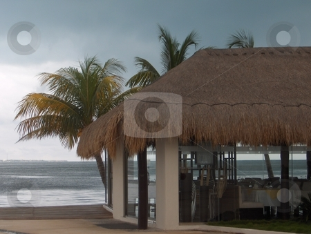 Mexico  stock photo, Thatched hut at a Mexican resort looking out over the ocean by Jessica Tooley